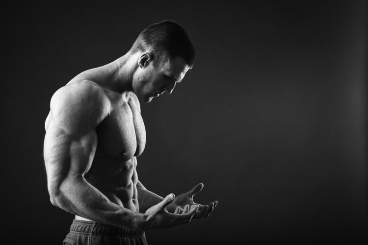Muscle Guy Stares At Hands