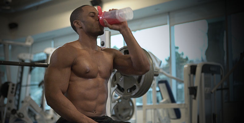 Man drinking shake in gym