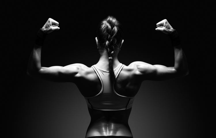 woman flexes muscle